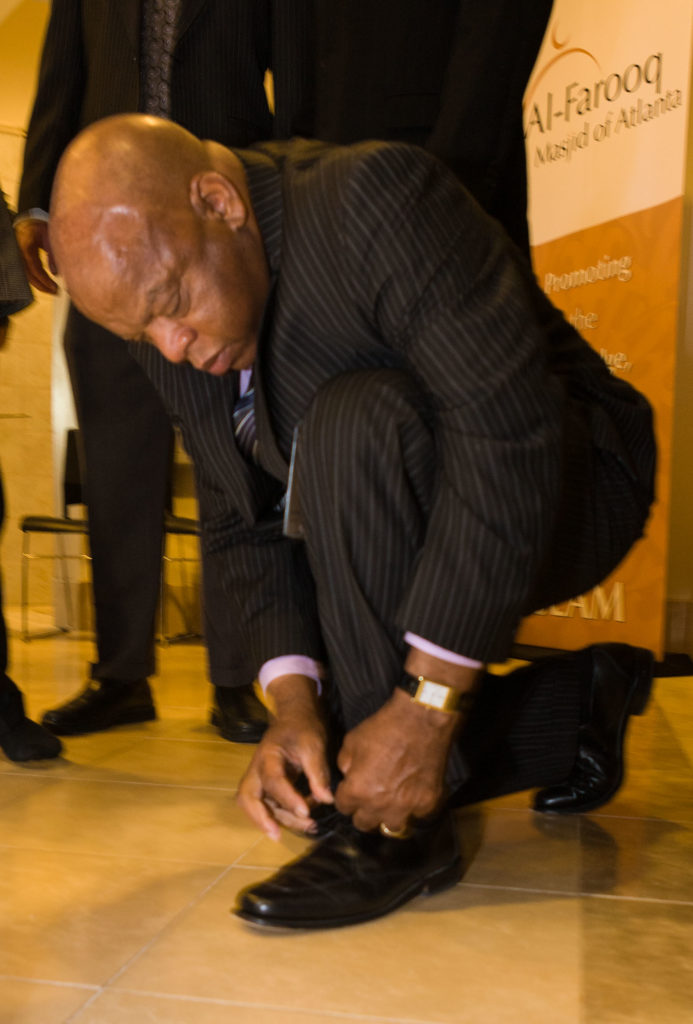John Lewis ties his shoe in the lobby of the Al-Farooq Mosque in Atlanta, Georgia August 17, 2008. Photo by Kevin Ames